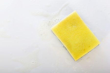 scour: scrubber pad with sponge and bubble of washing liquid