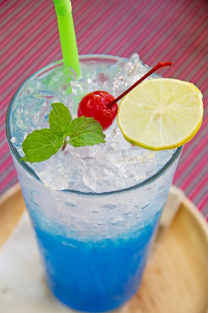 lemon: blue hawaiian soda with peppermint and lemon on top Stock Photo