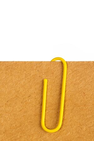 attached: paper clip attached to sheets of paper