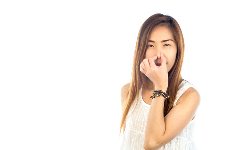 stinks: Portrait young woman, disgust on face nose , something stinks, very bad smell, isolated white background