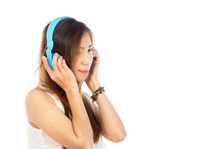 music background: lifestyle Woman listening to music isolated white background Stock Photo