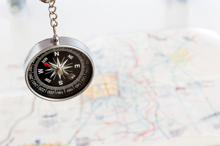 educacion fisica: compass on the tourist map. Focus on the compass needle