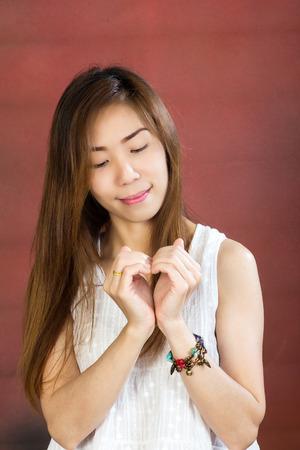 show of hands: Woman show heart hands