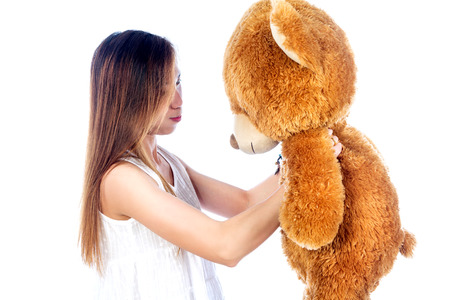adult toys: Portrait of beautiful young woman with Teddy Bear, isolated on white background Stock Photo