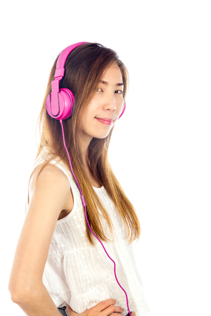 background people: lifestyle Woman listening to music isolated white background Stock Photo