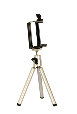 telephones: Small tripod made of aluminum. Tripod for small cameras and telephones on white background