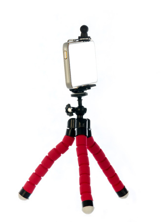 Small tripod made of aluminum. Tripod for small cameras and telephones on white background