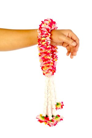 Asian womans hand holding garland isolated on white background
