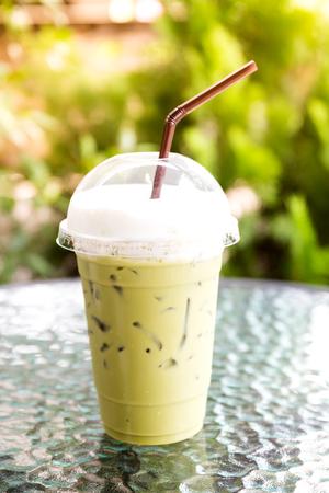 Iced green tea on table