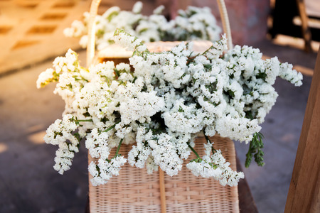White gypsophila bouquet in basket Stock Photo
