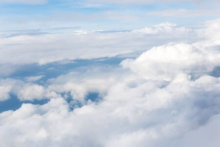 clouds and blue sky seen from plane Imagens