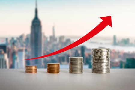 Stacks of coins in a growth real estate concept.