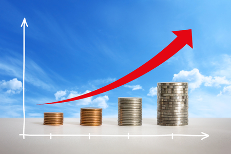 economic forecast: Stacks of coins in a growth financial concept. Stock Photo