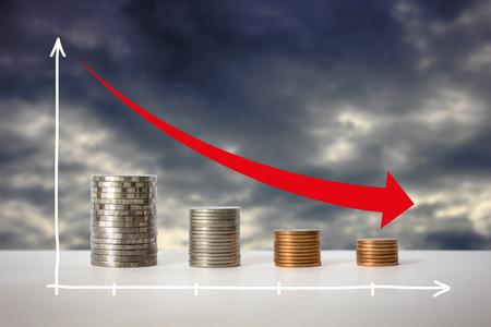 Stacks of coins in a decrease financial concept. Stock Photo
