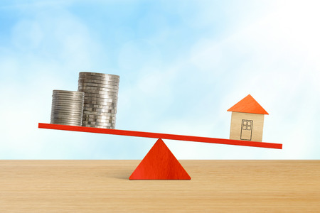 Investment weighting between banking and property.  Balance between Life And Work on seesaw.   Choosing between family and money on seesaw.