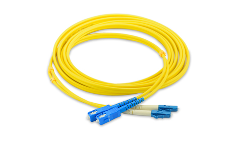 Fiber optics single mode patch cord SC to LC connector, isolated on white background Фото со стока