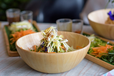 Rice salad set on wood plate, Khao yam, Thai cuisine Stock Photo