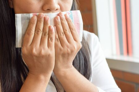 gag: The illness woman using tissues when coughing gag
