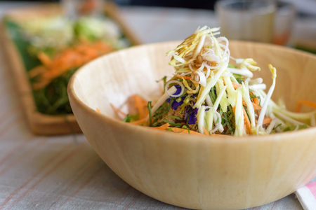 Rice salad set on wood plate, Khao yam, Thai cuisine Stock Photo