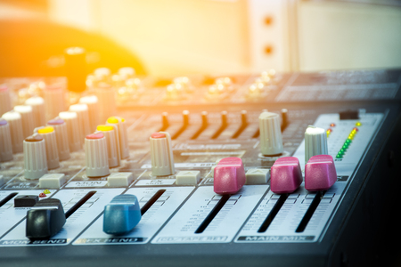 Sound mixer console with main mix slider over level position Stock Photo