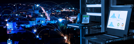 Management and monitoring monitor in data center and connectivity lines over night city background, smart city concept Foto de archivo