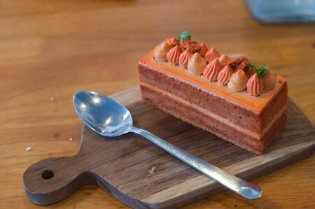 Homemade Thai tea cake on wooden plate Фото со стока