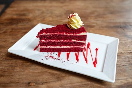 Homemade red velvet cake on white plate