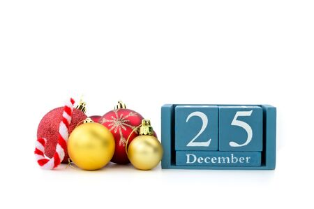25th December of wood calendar with xmas ornament on white background Фото со стока