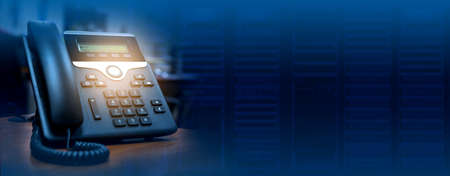 IP telephone device on blurred data center background with copy space, web banner or header design Фото со стока