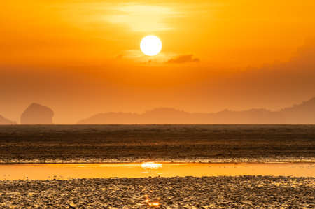 Landscape of beach over orange sunshine Фото со стока