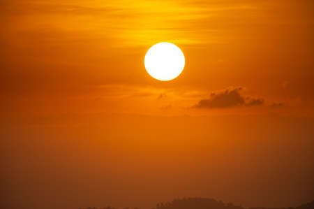 Sun on orange sky with cloud Фото со стока