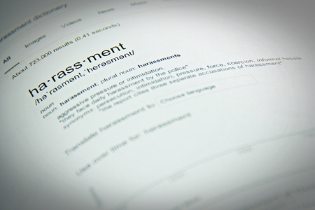 Business concept : The word harassment, close up, selective focus