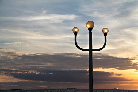 sky lantern: Lamppost and sunset sky, lantern at sunset, light pole with sunset