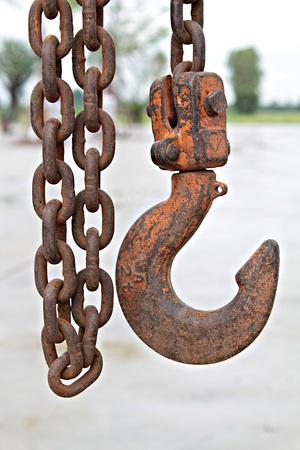 Close up of old rusty metal chain and hook at construction site, old chain and hook, rusty chain and hook Stock Photo