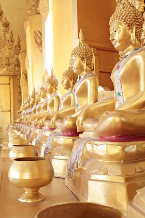 limosna: Golden monks alms bowl and golden buddha statue at Paknam Jolo Temple, Bangkhla, Thailand