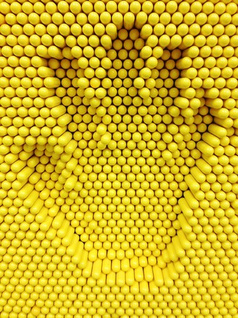prin: Hand print on the yellow pins toy background, playground equipment board for print hand Foto de archivo