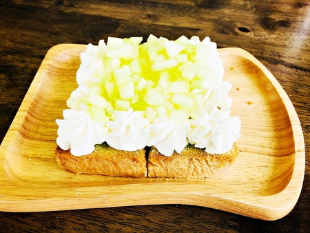 Food concept : Melon fruit toast on wooden plate