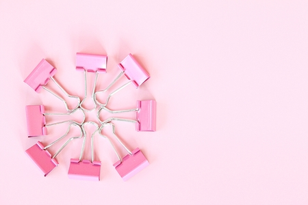 Business, corporation, collaboration, unity or teamwork concept : Group of pink binder clip on pink background with copy space Archivio Fotografico