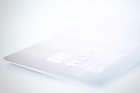 Business, finance, shopping, loans or money management concept : Credit card close up shot with soft focus for background