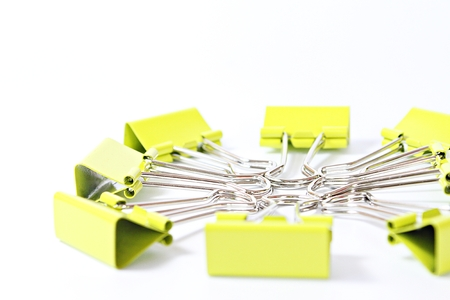 Business, corporation, collaboration, unity or teamwork concept : Group of green binder clip on white background with copy space