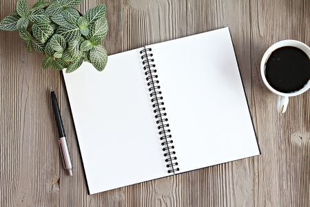 Still life, business, office supplies, planning or office life concept : Top view or flat lay of open notebook with blank pages, coffee on office desk table with copy space ready for adding or mock up Archivio Fotografico