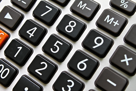 Business, finance, savings money, investment, taxes or accounting concept : Close up of black button calculator