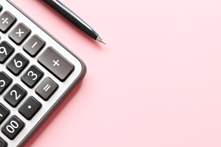 Business, finance, savings money, investment, taxes or accounting concept : Top view or flat lay of calculator and pen on pink background with copy space ready for adding or mock up