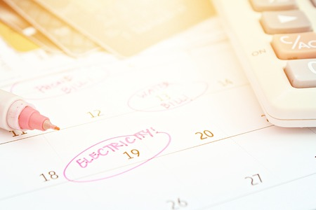 Business, finance, savings money, wages, payroll, bills or accounting concept : Calendar with pink marker circle in word electricity for remind Archivio Fotografico - 126599748