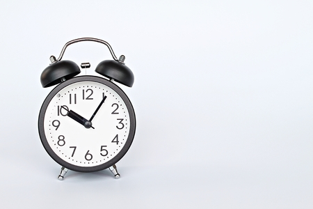 Still life, business deadline, meeting, savings time and time management concept : Black retro alarm clock on white background with copy space, ready for adding or mock up