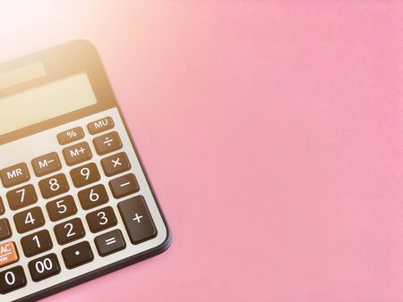 Business, finance, savings money, investment, taxes or accounting concept : Top view or flat lay of calculator on pink background with copy space ready for adding or mock up