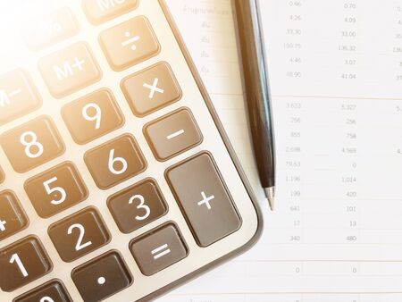 Business,finance, taxes, accounting, investment or money planning concepts : Calculator and pen on financial statements Archivio Fotografico - 134868855