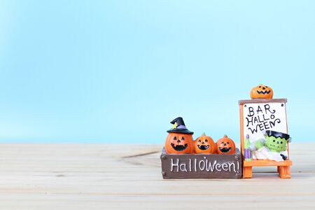 Halloween holiday background concept : Halloween decoration on table and blue background with copy space, ready for adding or mock up