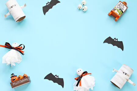 Halloween holiday background concept : Top view or flat lay of Halloween decoration with ghosts and bat on blue background with copy space, ready for adding or mock up Zdjęcie Seryjne