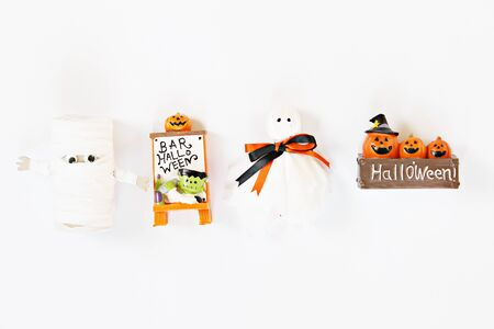Halloween holiday background concept : Top view or flat lay of Halloween decoration with ghosts on white background with copy space, ready for adding or mock up